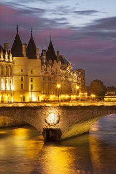 Twilight over the Conciergerie and Pont au Change along the River Seine, Paris France
