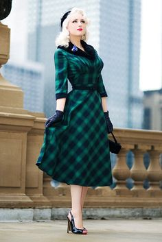 Voodoo Vixen Retro Vintage Lola Plaid Faux Fur Collar 3/4 Sleeve Swing Dress at Amazon Women's Clothing store:  https://www.amazon.com/gp/product/B01N8YRM8R/ref=as_li_qf_sp_asin_il_tl?ie=UTF8&tag=rockaclothsto_toys-20&camp=1789&creative=9325&linkCode=as2&creativeASIN=B01N8YRM8R&linkId=91a440ff711042b9af6bd879e412251c