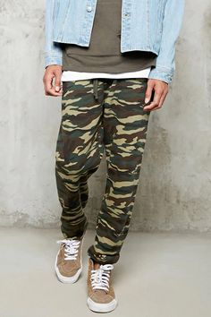 A pair of fleece knit sweatpants with an allover camo print, an elasticized drawstring waist, elasticized ankles, and a back patch pocket.