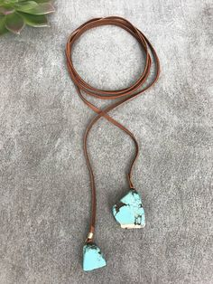 Add a little native american southwestern flair to your threads with this wrap choker necklace made with genuine leather, lariat style featuring turquoise drop slab stones <><><><><><><><><><><><><><><><><><><><><><><><><><><><><><> ITEM DETAILS -- -Layered wrap choker + tie knot lariat style necklace -Key Feature: ...