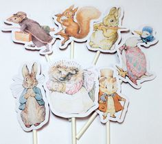 These Classic Beatrix Potter Cupcake Toppers are perfect for your baby shower or birthday party. They can be used to adorn cupcakes, decorate a cake or food platter. 14 Beatrix Potter cupcake toppers can be purchased as either regular one sided (illustration on front and plain white cardstock on back) or two sided. Please be sure to pick your style at checkout otherwise you will be sent regular one sided by default. Included are 2 each of Benjamin Bunny, Peter Rabbit, Squirrel Nutkin, The…