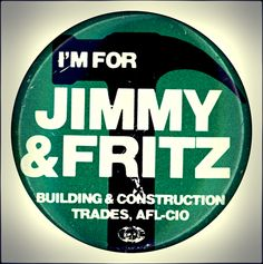 """Campaign button promoting the support of the Building & Construction Trades union for Democratic presidential hopeful Jimmy Carter and his running mate, Walter """"Fritz"""" Mondale, in 1976."""
