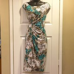 NWOT Lovely dress size M Lovely midi dress. Turquoise, lace, animal print. Beautiful cinch detail in the waste. Complements women's shape nicely. Size 8 or M/L. 41 inches shoulder to hem, 33 inches armpit to hem. Can be worn day or night. Fabric pretty stretchy might accommodate size 8-10. Never worn NWOT. Could be worn with flats or heels. Dresses Midi