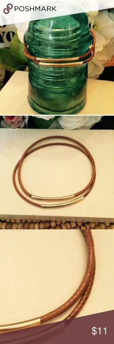 """Set of 2 Brown & Gold Leather Bangles Set of 2 beautiful hand made bangles. Brown with gold plated tubes. Slide easily on your arm indiviually or stack them. The leather cord holds it's round shape nicely. Size is 8"""" around. A.K.Lily Jewelry Bracelets"""
