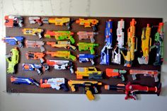 Looking to successfully store your child's Nerf gun collection? Here are some amazing Nerf gun storage solutions including an easy Nerf gun peg board hack. Nerf Gun Storage, Toy Storage, Storage Ideas, Kids Storage, Arma Nerf, Pistola Nerf, Army Decor, Nerf War, Toy Rooms