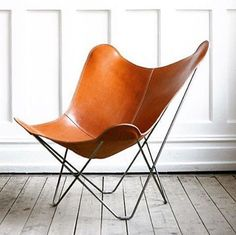 The most gorgeous tan leather butterfly chair to land on our shores, beautiful craftsmanship and comfort #curiousgrace #furniture #interiordesign #styling #armchair #leather #midcenturymodern