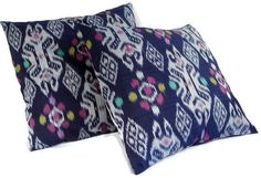 http://www.etsy.com/listing/78714943/ikat-pillows-16x16-set-of-2-blue-gray