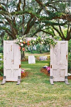 24 Fabulous Rustic Old Door Wedding Decoration Ideas ❤ See more: http://www.weddingforward.com/old-door-wedding-decoration-ideas/ #weddings #decoration wedding ceremony freestanding doors and folaige flowers