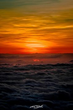 Haleakala is known for amazing sunrises but if you are not a morning person the sunset is just as beautiful and then get to see the remarkable stars. This sunset was particularly amazing with the orange and gold colors shining through over the clouds.