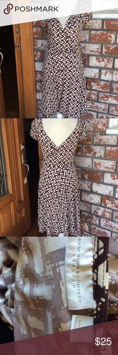 Comfy v neck dress Comfy v neck all around short sleeve had decorated buckle on front New York & Company Dresses Midi