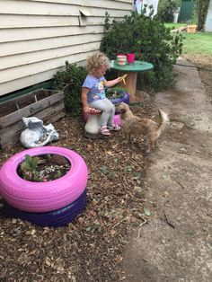 Use old cable drums as a kid size potting table for mini Gardeners