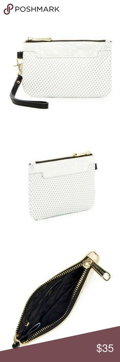 "Nwt! Poverty Flats by Rian Wristlet Nwt! Poverty Flats by Rian Faux Leather Wristlet  -detachable wrist strap -zip closure -interior features 1 zip wall pocket -approximately 4.5"" height and 6.5"" width  -approximately 8"" strap length -color is silver Poverty Flats by Rian Bags"