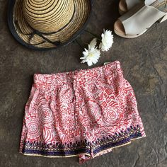Print Shorts Who wears short shorts?? These cuties have a red detailed print with navy blue & yellow trim. Front elastic waist tie.  trades Trindy Clozet Boutique Shorts