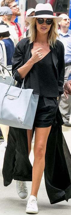 Who made  Rosie Huntington-Whiteley's tan hat, black coat, diamond jewelry, black sunglasses, blue tote handbag, and white sneakers?