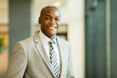 young african american businessman closeup portrait stock photo