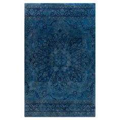 Anchor your living room or den with this lovely hand-tufted rug, showcasing a Persian-style motif in blue.  Product: Rug
