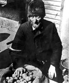 Warsaw, Poland, A Jewish man selling potatoes in the ghetto market. The time will come soon where this was a rare luxury to find eatable food