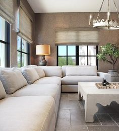 Large sectional sofa and subtle patterned wallpaper design | H. Ryan Studio