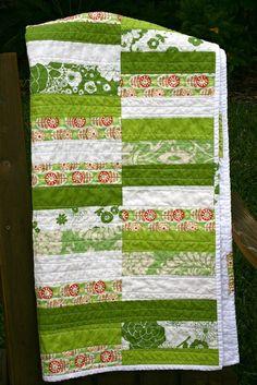 green striped quilt.
