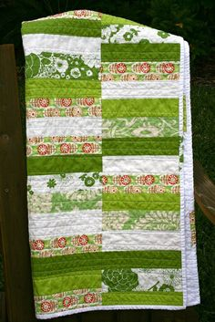 Green striped quilt.