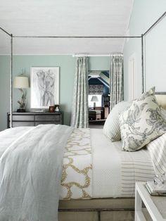 bedrooms - blue green walls black dresser iron canopy bed blue gray linen duvet ticking pillow gold striped bedding blue green damask drapes.