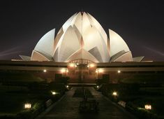 The Lotus Temple: house of worship    The Lotus Temple is a house of worship for the Bahá'í religion and earns its name for its flower-like shape (the lotus being a sacred flower for many Indian religions). This tied in nicely with the fact that the building had to be a nine-sided circular shape, which is a specified requirement for a religious building according to Bahá'í scripture.