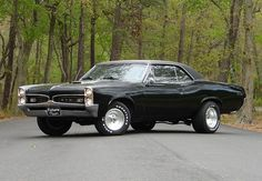 A car just like this one my friend owned in High School that we used to cruise Van Nuys Blvd. With a six pack under the hood. 1967 Pontiac GTO Coupe 6