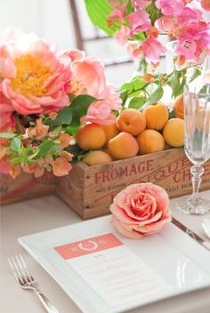 The combination of pink flowers, nectarines, a wooden cheese box and crisp white linens is a winner!