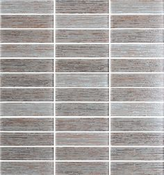"""Silk Series Hazelnut  Textured Glass Mosaic Tiles.  These tiles are 1"""" x 4"""" in size and come on a 12"""" x 12"""" mesh sheet. A silky mix of warm grey, beige, hints of cinnamon, and the tiniest amount of black come together in this Thai silk inspired glass mosaic tile. They also have a textured front which gives them a nice 3 dimensional feeling."""