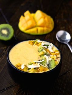 To try a sweet and tropical smoothie bowl that is both beneficial to your health and super tasty, click through! You'll be able to whip this up in a jiffy! Savor the flavor and repin for later!  #tropical