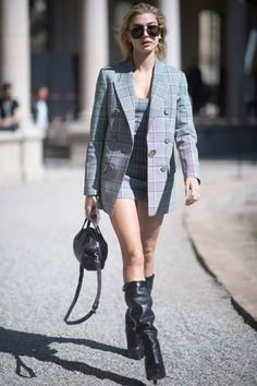 20 September Hailey Baldwin kept it simple and chic in a grey checked blazer and matching dress while out in Milan.