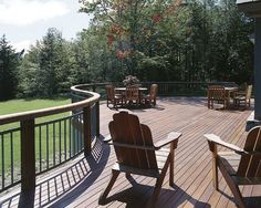 A curved deck design complete with sunning Cape Cod chairs and picnicing area.