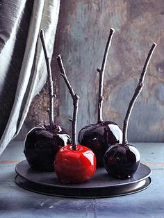 Love these glossy, creepy-looking candy apples for #Halloween! http://www.people.com/people/package/gallery/0,,20058392_20634461,00.html#21220480