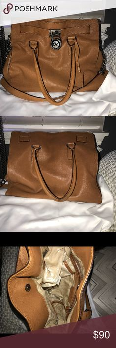 "Michael kors Hamilton Authentic large Michael kors Hamilton in camel with silver hardware. The leather is soft for a ""slouchy"" look. This bag is in excellent condition. no rips, lock and key works! The only flaw is shown on the second picture the handle toward the back has some staining but it is not that noticeable unless you're looking up close. Bottom has normal wear as seen on picture. You can buff it out I just haven't tried. Dust bag will be included Michael Kors Bags Shoulder Bags"