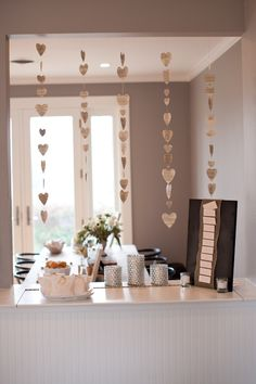 This could be accomplished for winter with a cardstock paper for snowflakes. Could hang behind/above gift table - or someone at the reception?