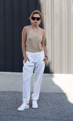 White trousers with a beige cami + Stan Smiths.