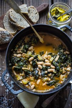 Ribollita with Cannellini beans, lacinato kale, and vegetables, served w/ crusty bread, drizzled with a Lemon Rosemary Garlic Oil Slow Carb Recipes, Soup Recipes, Whole Food Recipes, Cooking Recipes, Healthy Recipes, Chicken Recipes, Tuscan Soup, Cooking For Beginners, Bean Stew