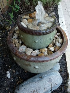 Just finished my own version of this - I don't like the spout at the top, my fountain ends below the water level of the top pot... :)