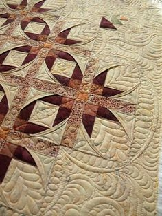 Batik stars quilt by Lisa, longarm quilting by Jenny's Doodling Needle.