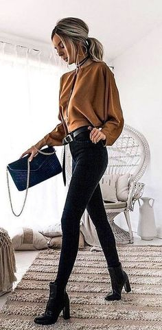 #fall #outfits  women's brown long-sleeved shirt and black skinny jeans