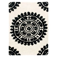 Tufted New Zealand wool rug with a medallion motif.  Product: RugConstruction Material: New Zealand wool