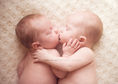 twin smooch. My boys used to do this, although it was typically Max trying to EAT Drew.