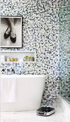 :: Modern Tiled Bathroom ::  A clean-lined, freestanding white bathtub contrasts nicely against dramatic walls.