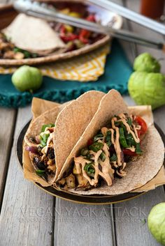 Beefy Jackfruit Tacos with grilled fajita veggies and seasoned sour cream sauce. Easy and perfect for summer!