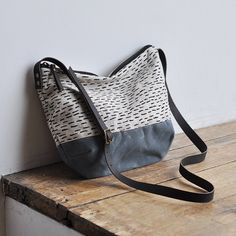 a great size bag for all essentials you need for your day outer fabric is a light weight oatmeal linen printed with our rain pattern in a black