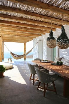A fringed hammock blends seamlessly into the rustic-chic decor of Kokkina Villa on the Greek island of Syros. Mediterranean House Plans, Mediterranean Architecture, Mediterranean Home Decor, Greek Decor, Greece Pictures, Plans Architecture, Vernacular Architecture, The Last Summer, Rustic Chic Decor