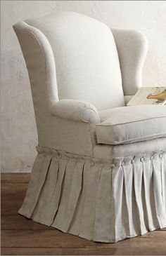 Button hem wing back chair