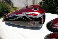 peinture moto et aérographe à pau,aquitaine ,landes, honda skull, tribal et candy rouge 4