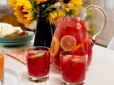 : Sinless Sangria  YIELD:6 to 8 servings LEVEL:Easy INGREDIENTS  1 liter sparkling white grape juice, chilled 1 cup cranberry juice 1 cup orange juice 1/4 cup fresh lime juice 2 cups assorted citrus fruit ( oranges, lemons, limes), thinly sliced 1/2 cup fresh strawberries, sliced Fresh mint sprigs, for garnish