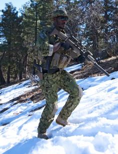 A Navy SEAL in training. Note the Sig P226 Mk25 in the holster (photo by SEALs).